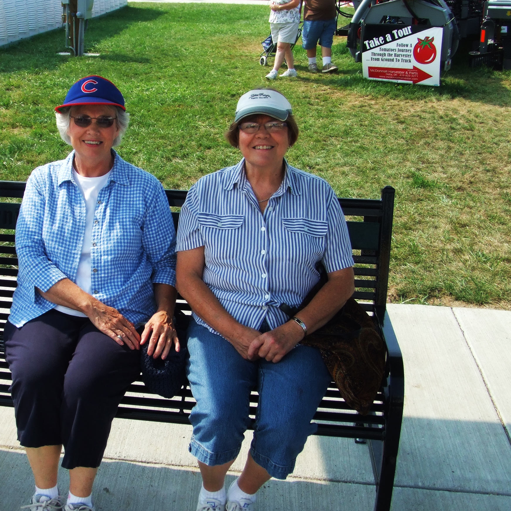 Friends enjoying a donated park bench from OCC Outdoors