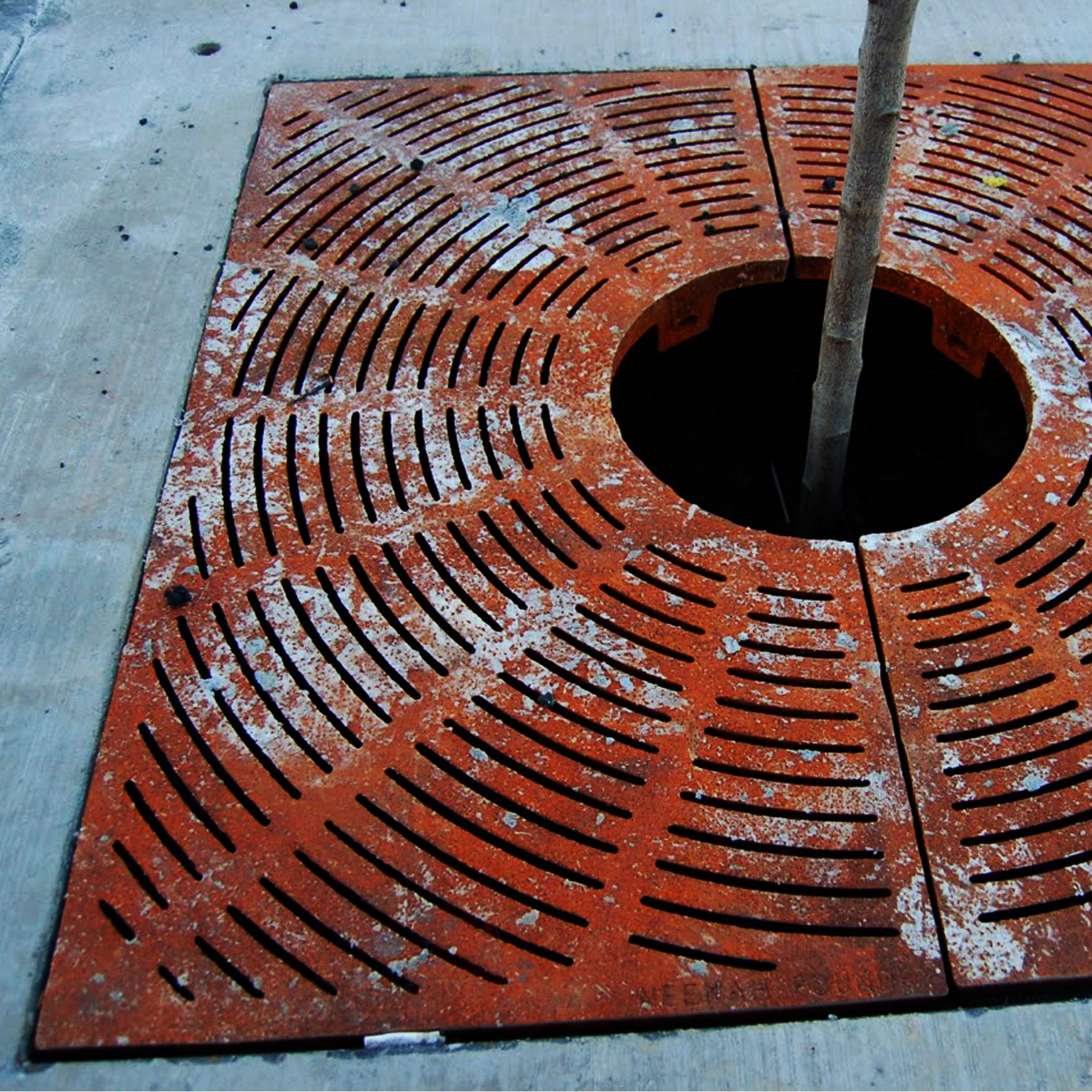 Unsightly Rusted Steel Tree Grate - Try Recycled Plastic Instead